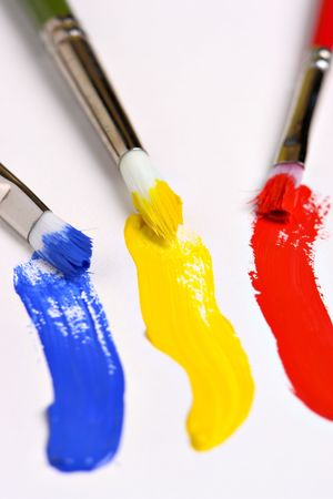 Three brushes and primary colors