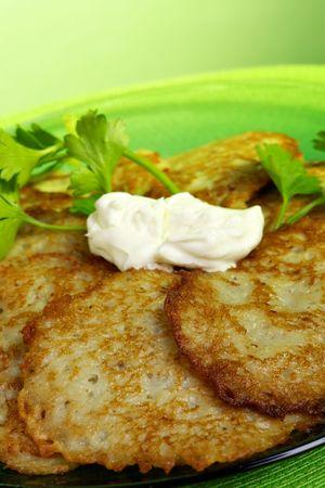 fritter: Potato Pancakes with sour cream