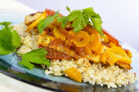 entrees: Moroccan Fish Tagine served on plate Stock Photo