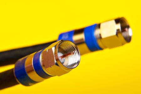 bandwith: Two Coax cables on yellow background