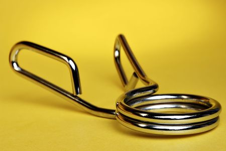 Hand Gripper on yellow background Stock Photo - 655020