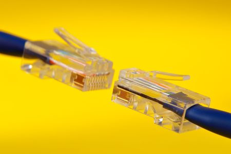 bandwith: Two handing RJ-45 cables on yellow background Stock Photo