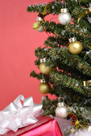 wrapped present: Christmas tree with a wrapped present