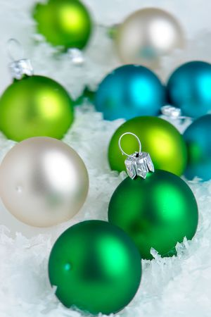 group of christmas baubles: Christmas decoration on white snow