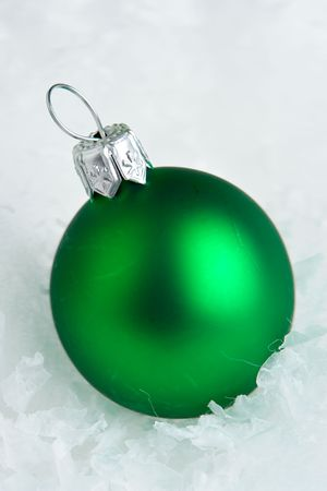 Macro of christmas bauble on white snow