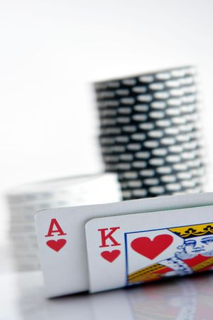 poker table: Pocker Ace and King with chips in background Editorial