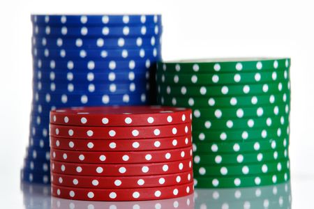 Poker chip stacks, isolated on a white background. photo