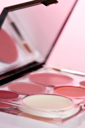 Cosmetic product close-up with pink cast Stock Photo
