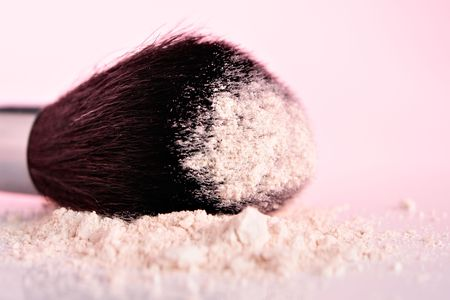 Cosmetic powder and brush Stock Photo