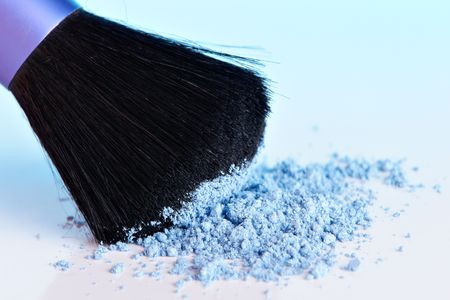 Cosmetic Powder and brush with blue cast