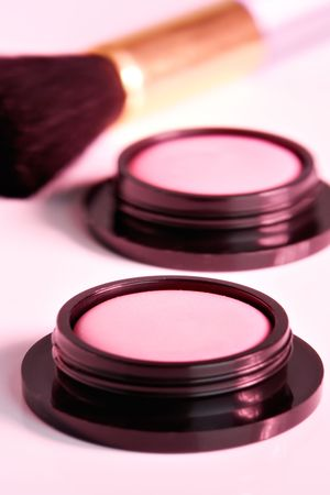 eyemakeup: Cosmetic product close-up with pink cast Stock Photo