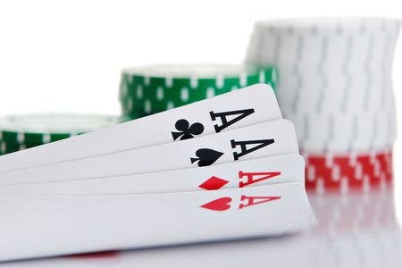 four of a kind: Four of a kind aces with chips in background Stock Photo