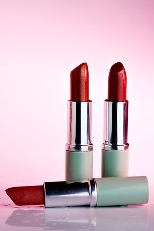 Three lipsticks with pink cast Stock Photo