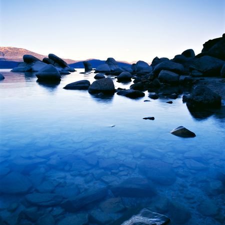 Lake Tahoe at sunset with blue cast Stock Photo
