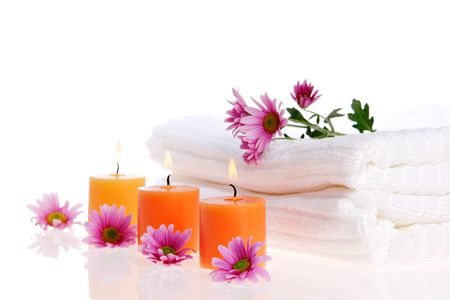 Candles, flowers, and white towels Stock Photo