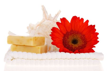 Soap bars, towel, and red flower photo
