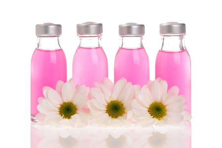 Spa bottles and daisies isolated on white background Stock Photo - 962589