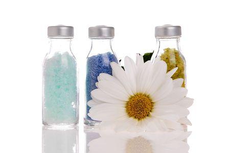 Spa bottles on white background