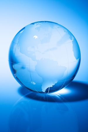 Glass world globe in blue tone