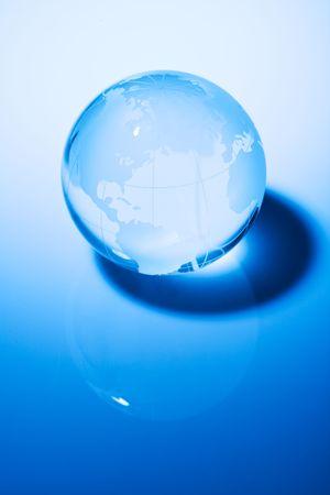 Glass world globe in blue tone