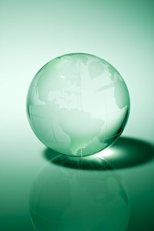 Glass world globe in green tone