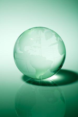 Glass world globe in green tone