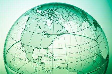 Green globe with backlit light Stock Photo