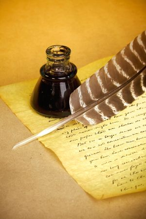 Quill, inkwell, and old letter with an antique look