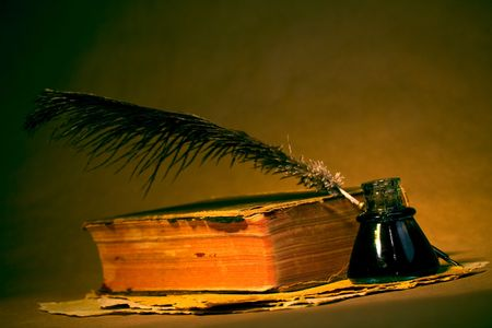 Quill, inkwell, book and paper with an antique look