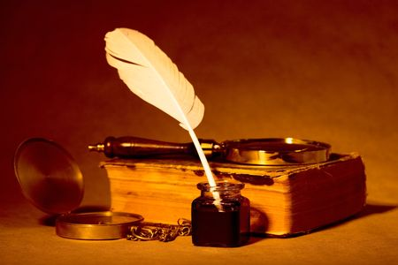 Quill, inkwell, compass, book with an antique look photo