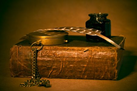 Quill, inkwell, compass, book with an antique look Stock Photo - 2597959