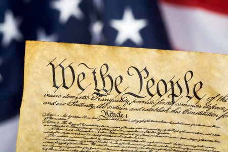 United States Constitution with Flag in background Stock Photo - 2597967