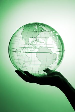 A hand holding translucent globe