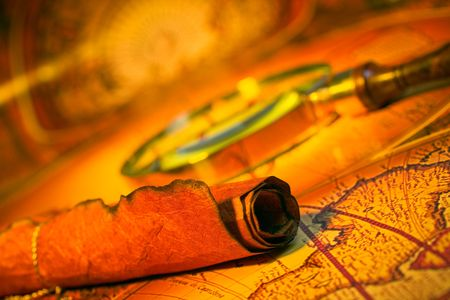 Magnifying glass, scroll, and map with antique look photo