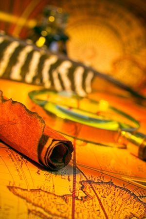 Magnifying glass, quill, scroll, and map with antique look Stock Photo - 2610530