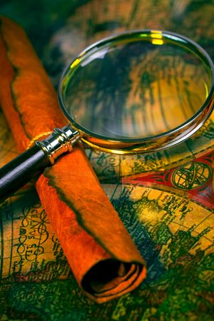 Magnifying glass, scroll, and map with antique look Stock Photo - 2610535