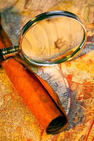 Magnifying glass, scroll, and map with antique look Imagens