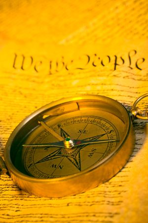 Antique compass and first words of United States Constitution