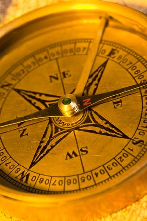 Old style gold compass with an antique look
