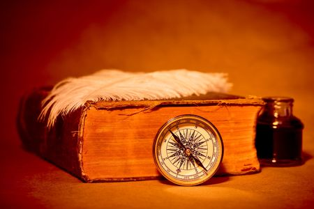 Quill, inkwell, compass, book with an antique look