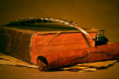 Quill, inkwell, book with an antique look photo
