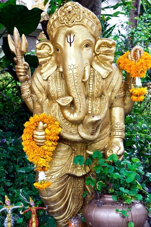 Golden statue of Ganesha in temple photo