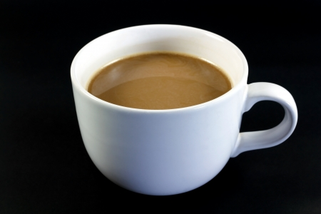 Coffee Cup against a black background photo