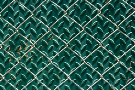 delimit: The chain link fence see steel background