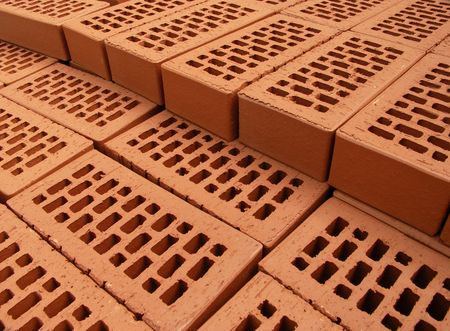 Pile of arranged new bricks on the site Stock Photo