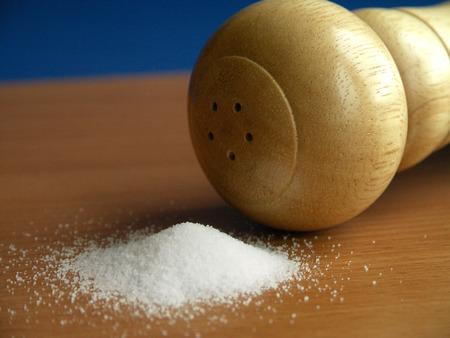 Saltshaker and  scattered salt