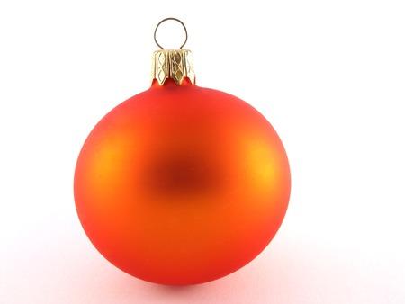 Orange glass ball on the light background.