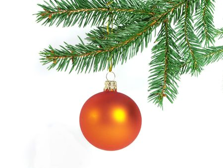 Orange glass ball hung on the Christmas tree. On the white background.
