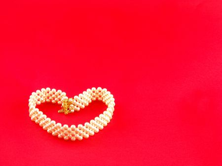 perls: Perls heart on a red background  Stock Photo