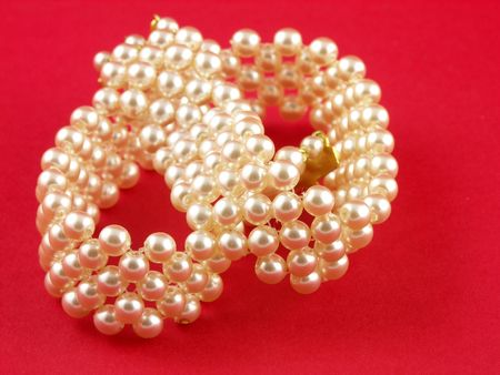 perls: Pearls on a red background